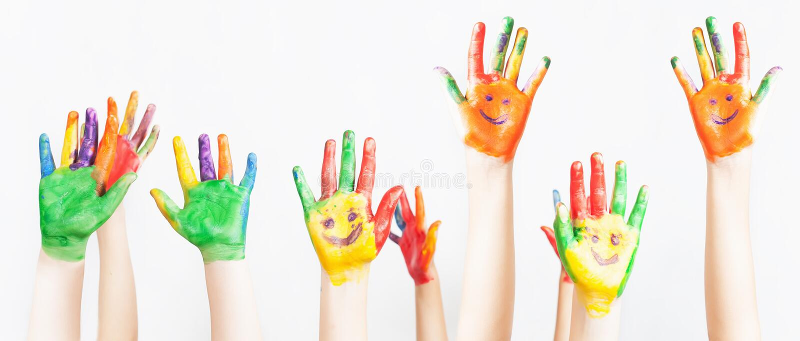 Lotten av målade händer lyftte upp, barns dag royaltyfria foton