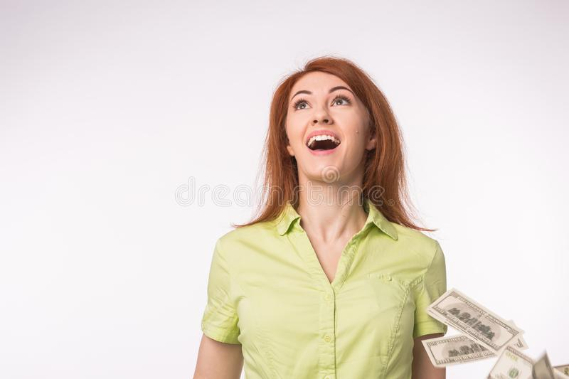 Lottery, financial success concept - Excited woman standing under money rain over white background royalty free stock images