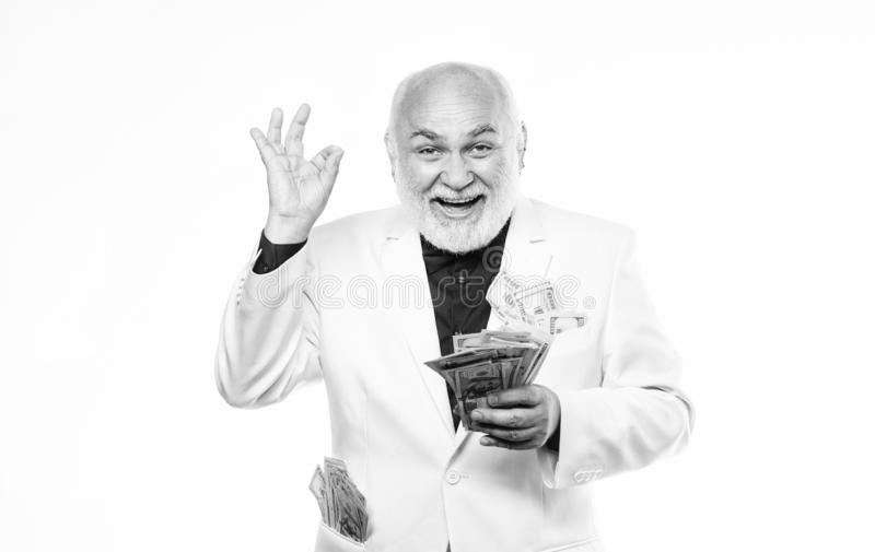 Lottery winnings. business success. Richness. rich mature man has lots of money. mature bearded man with dollar royalty free stock image