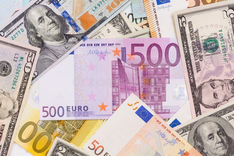 Lotto dei dollari e degli euro Fondo e struttura fotografia stock libera da diritti