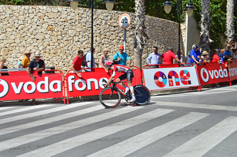 Lotto Soudal La Vuelta Espana Time Trial. The Lotto Soudal rider with arm and leg bandaged after an accident approaches the finish line of the time trial race royalty free stock photography