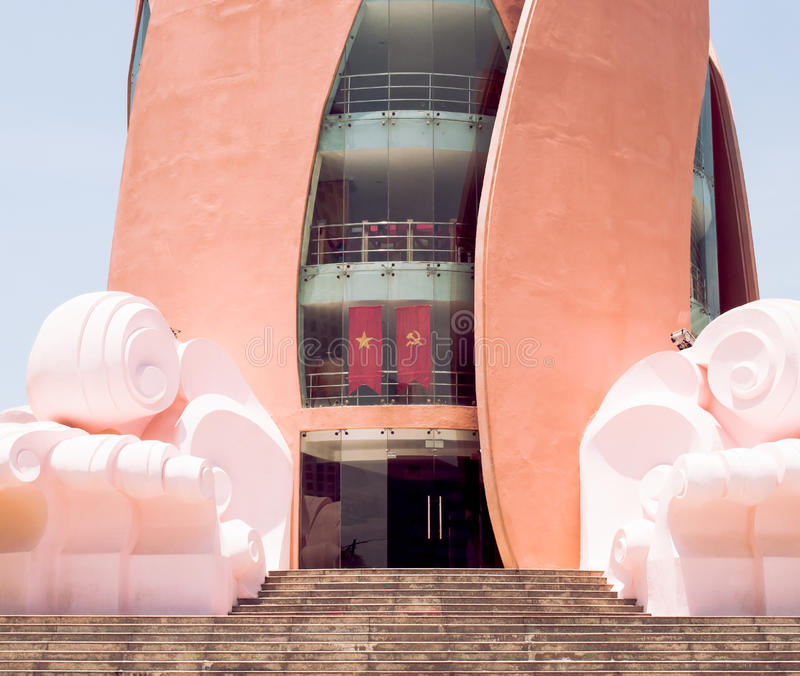 Lotus building or Tram Huong Tower Nha Trang Vietnam. Tram Huong Tower or Lotus building Nha Trang Vietnam with flags closeup view royalty free stock images