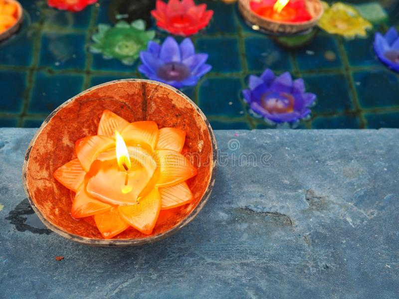 Lotus candle in a coconut shell. It is for Buddhism prays for Buddha. They are believe in Buddha. Candle light bring wishes by wat royalty free stock photo