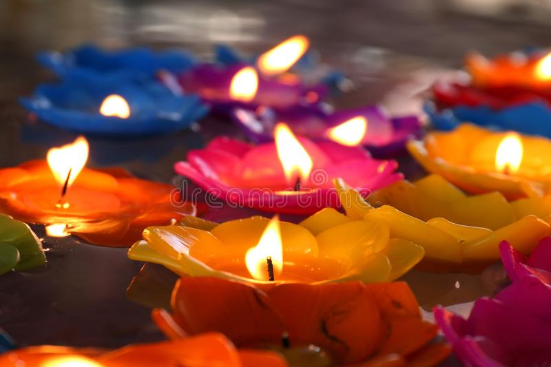 Lotus candle, lamp, lantern, light, Floating candles to be flower lotus burned on surface float on water with Buddhist beliefs stock image