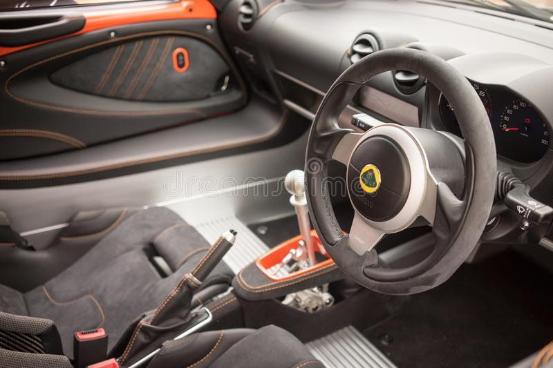 Charming A View Of The Interior Dashboard Of A Lotus Exige 380 Sports Car Showing  The Steering Wheel, Leather Seats And Controls. Lotus Cars Is A British  Company ...