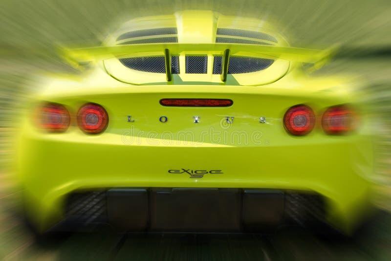 Lotus Exige Sports Car Rear amarilla con el movimiento foto de archivo libre de regalías