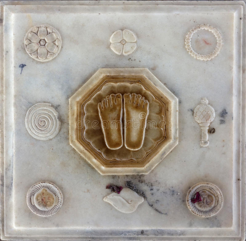 Lotus Feet of Guru Carving. This is a traditional shrine in India representing the feet of the guru, the teacher who removes ignorance. Surrounded by important stock image