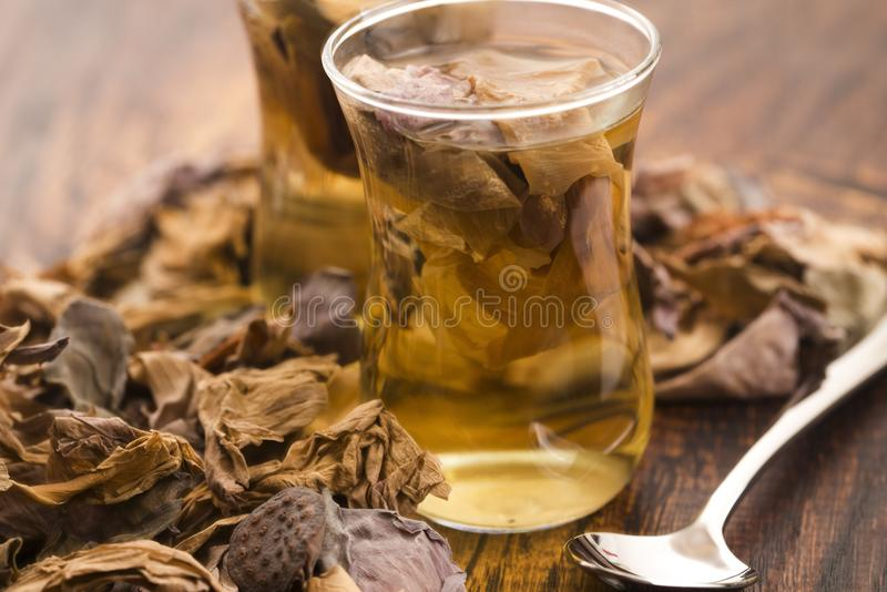 Lotus petals tea. On wooden background royalty free stock photo