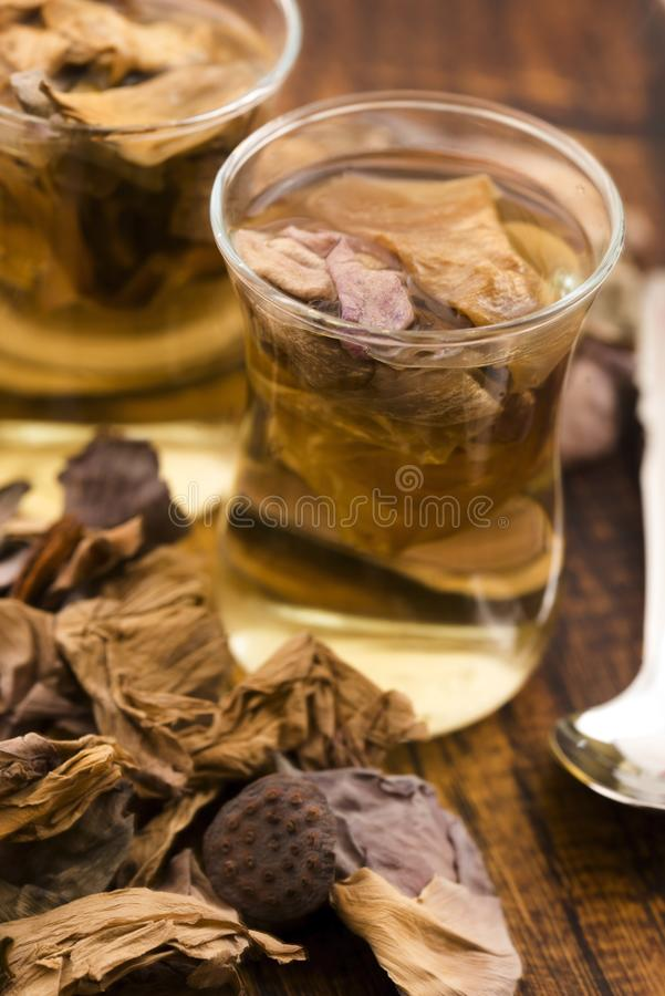 Lotus petals tea. On wooden background royalty free stock image
