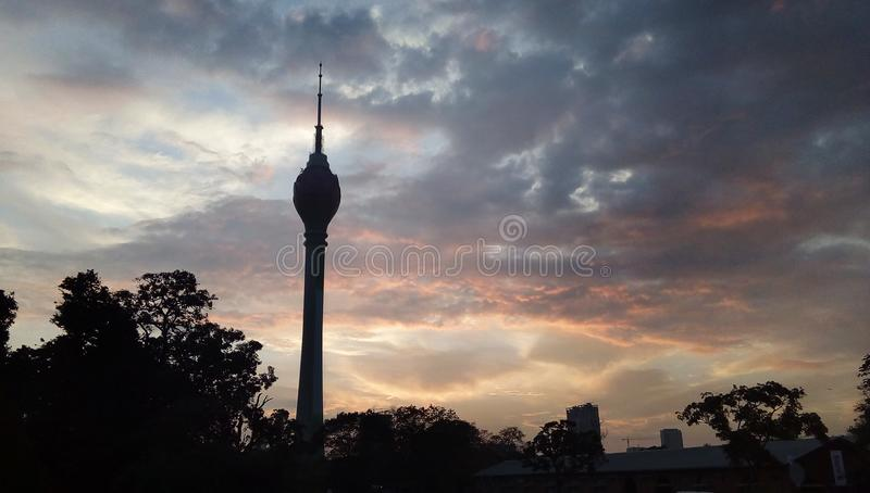 Lotus Tower in the evening with Sunset and clouds in the sky. In Sri Lanka royalty free stock photography