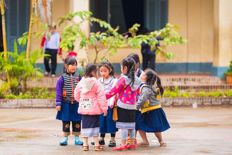 LOUANGPHABANG, LAOS - JANUARY 11, 2017: Children in the school yard. Copy space for text. Close-up. royalty free stock images
