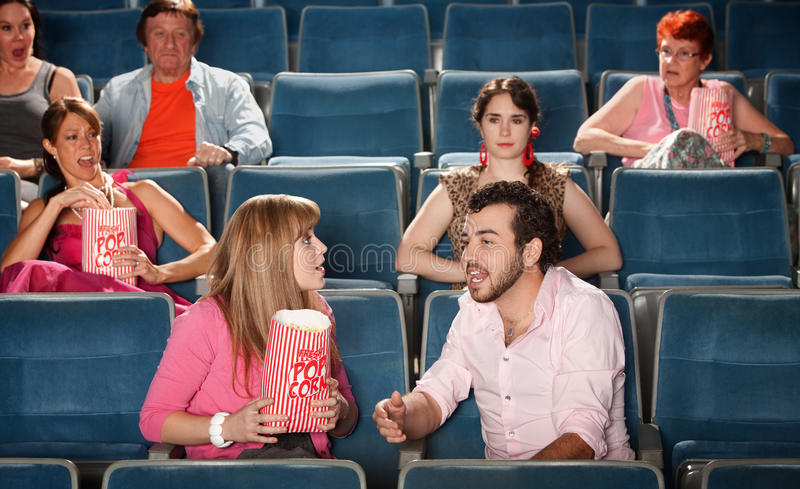 Loud Couple in Theater royalty free stock photo