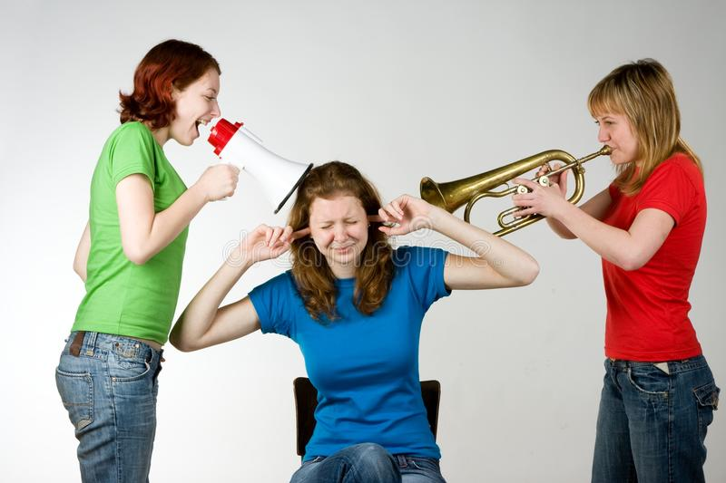 Loud friends bothering girl royalty free stock photos