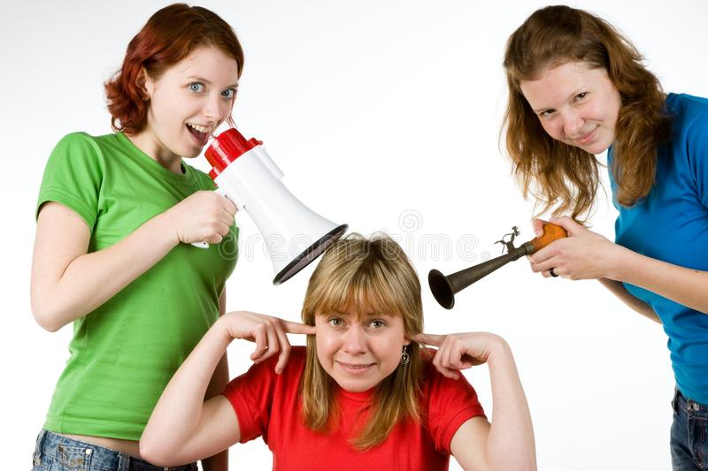 Loud friends bothering girl stock photos