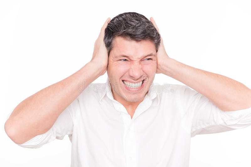 Loud man ear. Man affraid of loudness tapping ears with hands royalty free stock images