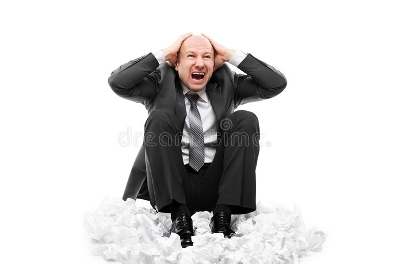 Loud shouting or screaming tired stressed businessman hands covering ears stock image