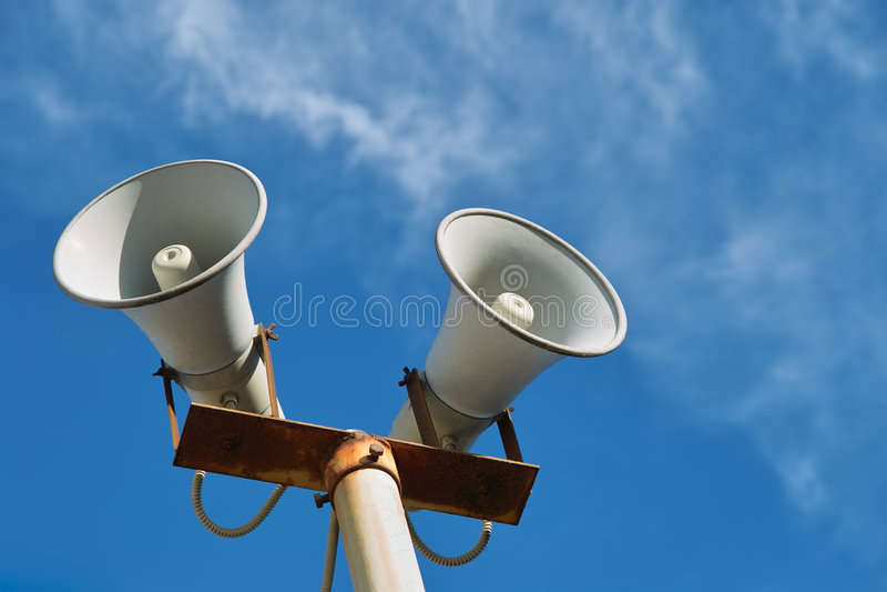 Loudspeaker. Against the blue sky stock images
