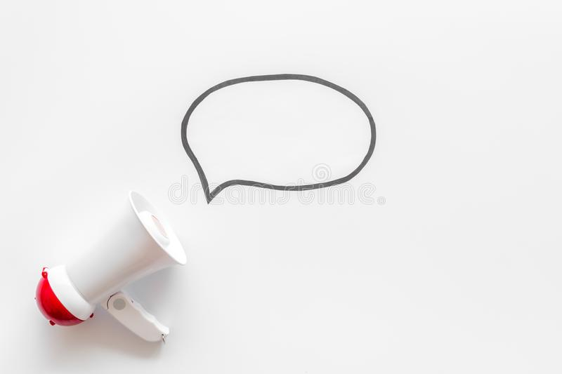 Loudspeaker with bubble for announcement text on white background top view mock up royalty free stock photography