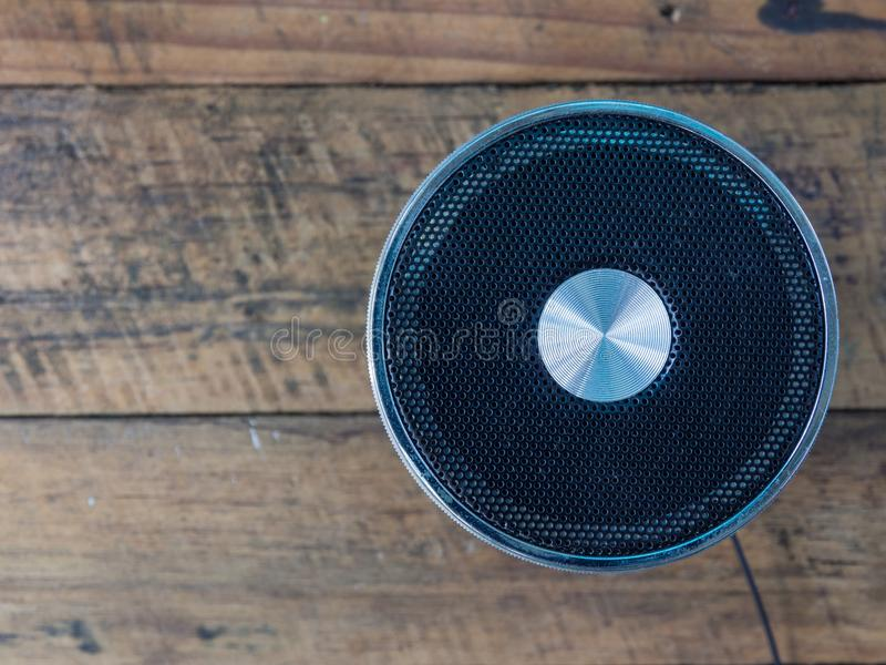 Loudspeaker. On wooden table royalty free stock photo