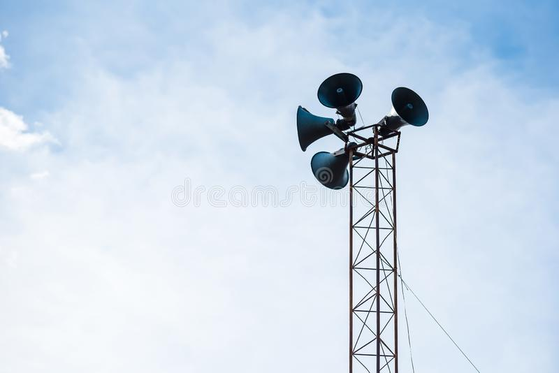 Loudspeakers on the pole against sky stock photography
