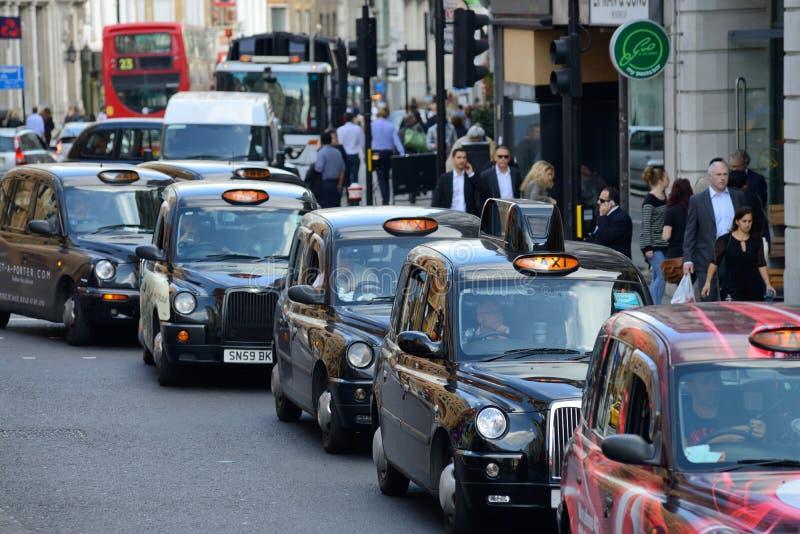 louez son taxi de Londres de lumière tourné images libres de droits