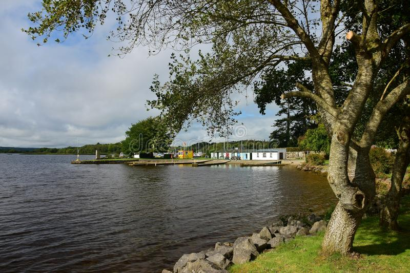 Lough Derg at Mountshannon in Ireland. The lake Lough Derg in Ireland, here at the small town Mountshannon. In the middle is the yellow shack of the life guards royalty free stock images