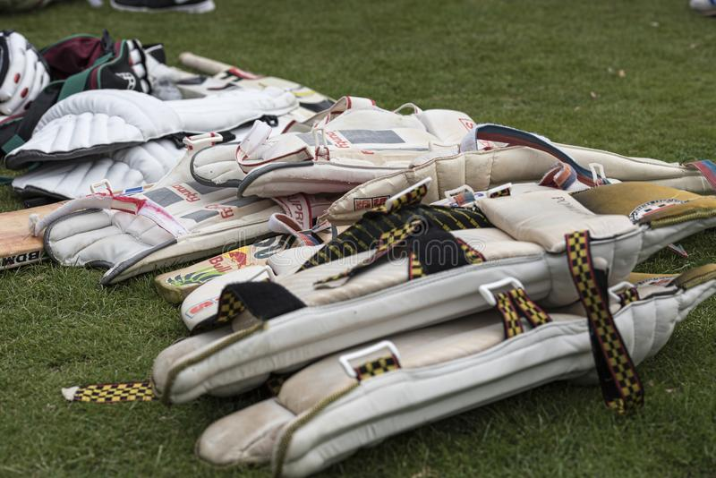 cricket equipment piled up ready for use at a local charity cricket match royalty free stock photos