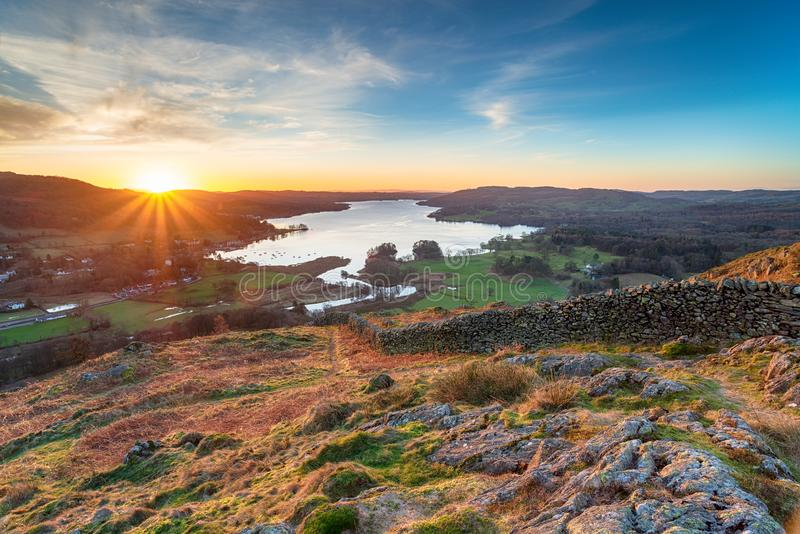 Loughrigg Fell in the Lake District. Stunning sunrise from Loughrigg Fell and looking out over lake Windermere stock images