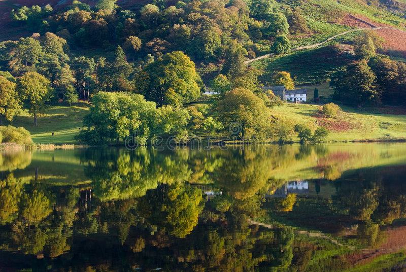 Loughrigg Tarn. An Autumn scene showing Loughrigg Tarn in the Lake District, UK stock images