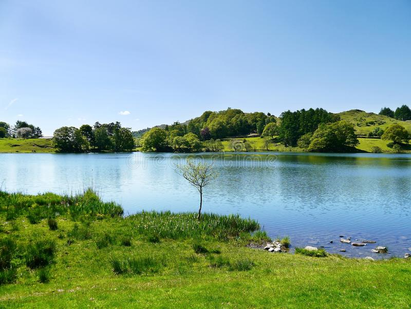 Loughrigg tarn, Lake District. Loughrigg tarn is fairly close to Ambleside and not that far from Grasmere stock photos