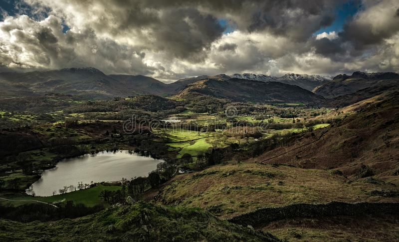 Loughrigg Tarn and the Langdale Pikes. From Loughrigg Fell, English Lake District stock image