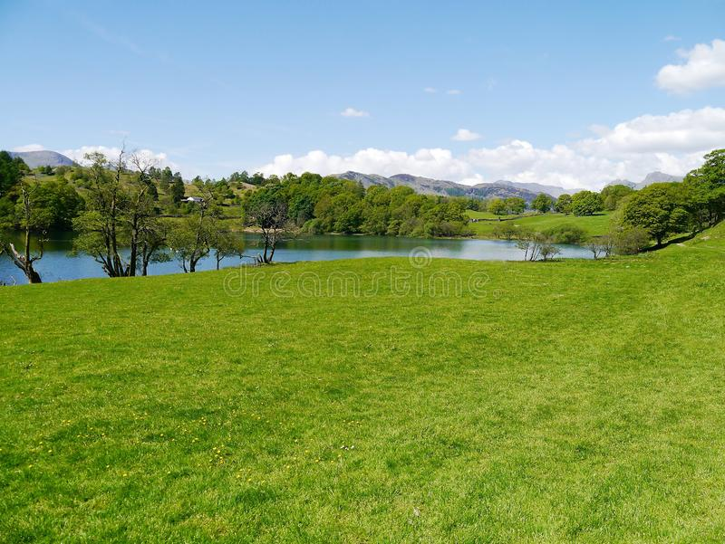 Loughrigg Tarn. Popular picnic area of Loughrigg Tarn, Lake District royalty free stock image