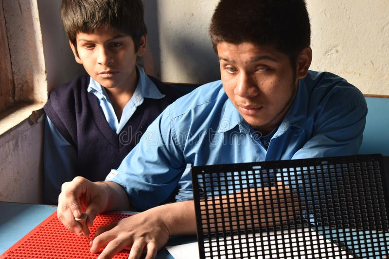 Louis Braille-Blind School In India. A visually impaired Indian student writes using the Braille system at The Louis Braille-blind school at West Bengal in India stock photography