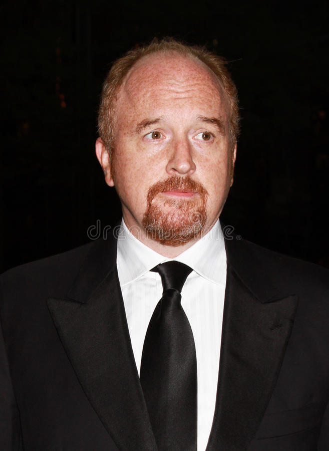 Louis CK. Comedian Louis CK looks uncharacteristically sartorially resplendent as he appears on the outdoor red carpet for Time's 100 Most Influential People stock image