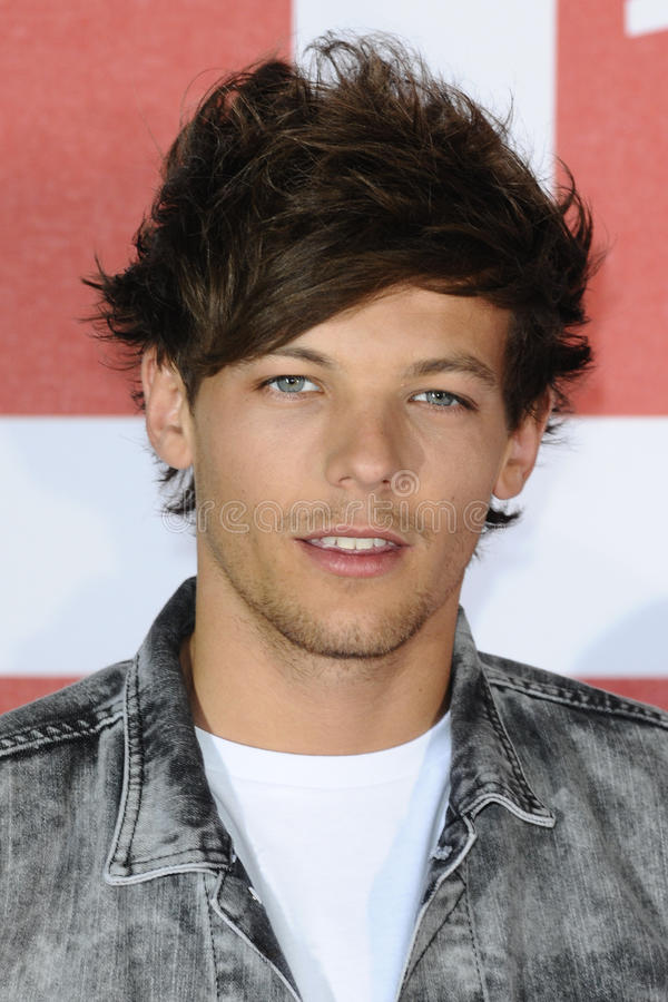 Louis Tomlinson. From One Direction at the One Direction This is Us film - press conference, London. 19/08/2013 Picture by: Steve Vas / Featureflash royalty free stock photo