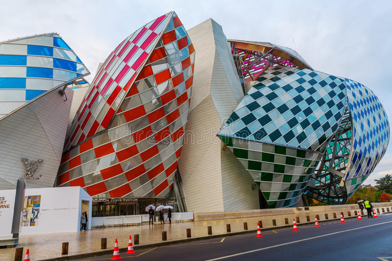 Louis Vuitton Foundation designed by Frank Gehry. Paris, France - October 20, 2016: Louis Vuitton Foundation in the Parc of Boulogne with unidentified people. It stock photos
