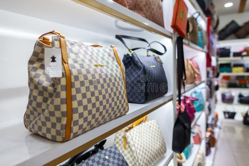 Louis Vuitton handbags stans in a shop stock image