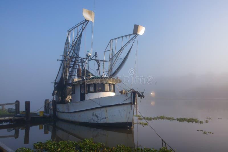 Louisiana Shrimp Boat. A shrimp boat at Golden Meadow, Louisiana on the Gulf Coast stock photo