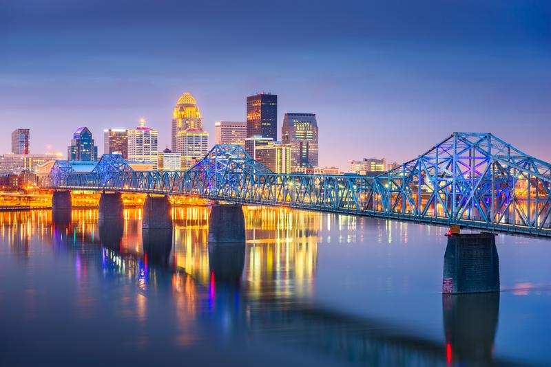 Louisville, Kentucky, USA downtown skyline on the Ohio River at dusk royalty free stock photo