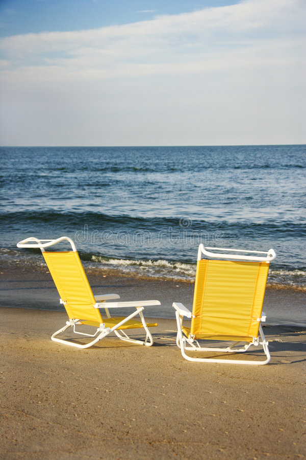 Lounge chairs on beach. royalty free stock images