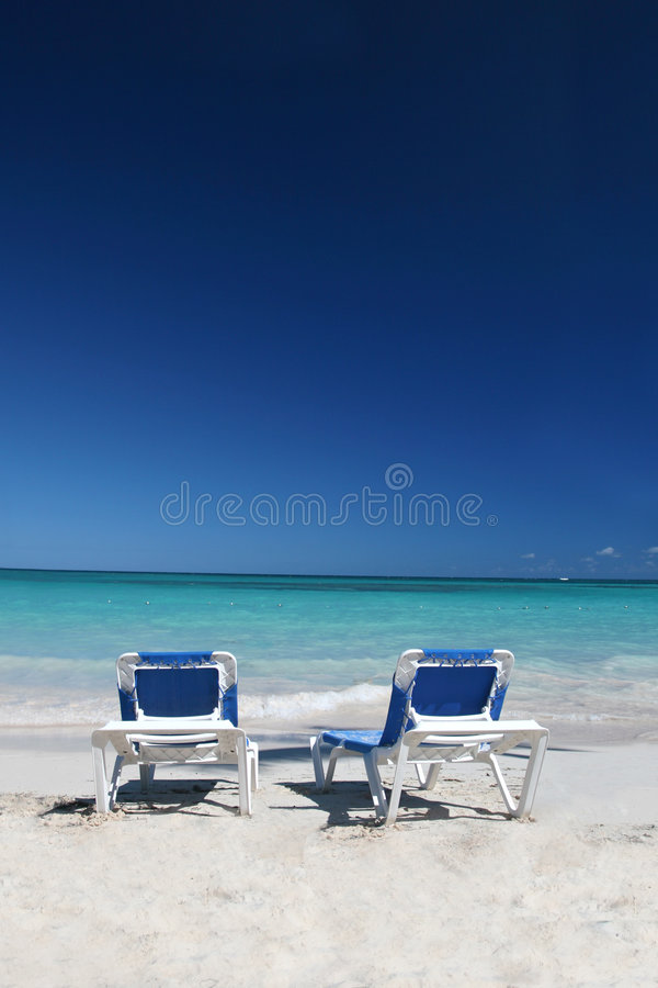 Download Lounge Chairs On Sand Beach And Ocean Stock Image - Image of escape, outdoors: 7767505