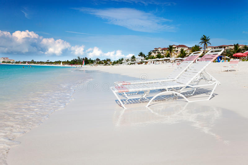 Download Lounge Chairs On Tranquil Grace Bay Beach Stock Image - Image: 19966627