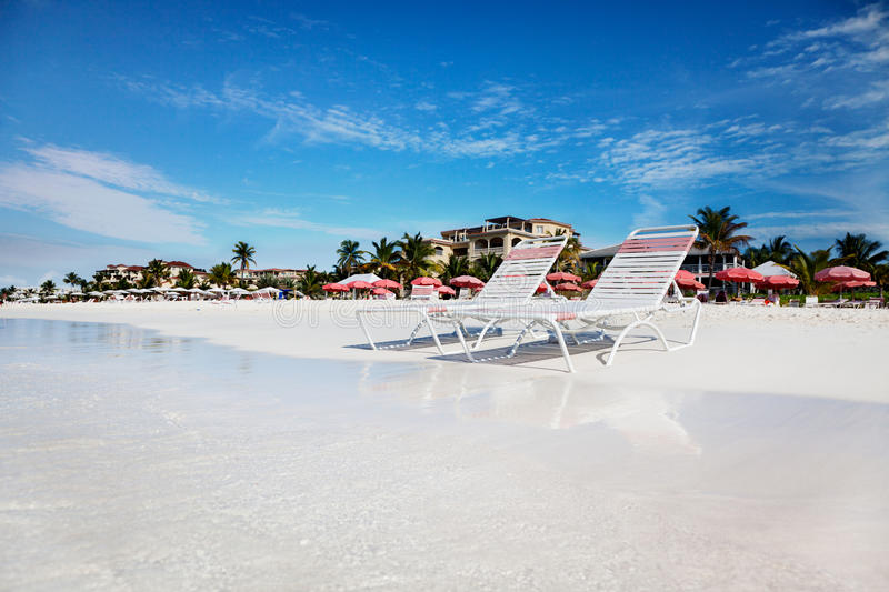 Lounge chairs on tranquil Grace Bay Beach royalty free stock photography