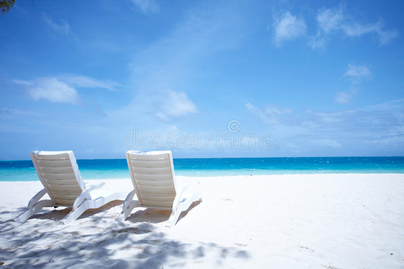 Download Lounge Chairs Tropical Beach Stock Image - Image: 10556065