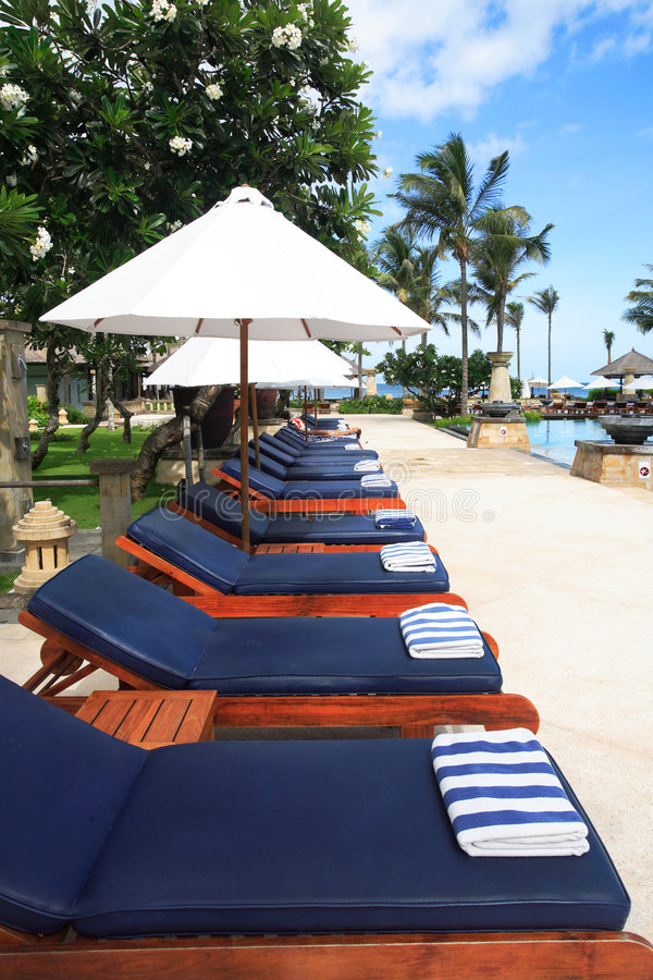 Lounge chairs umbrellas royalty free stock photo