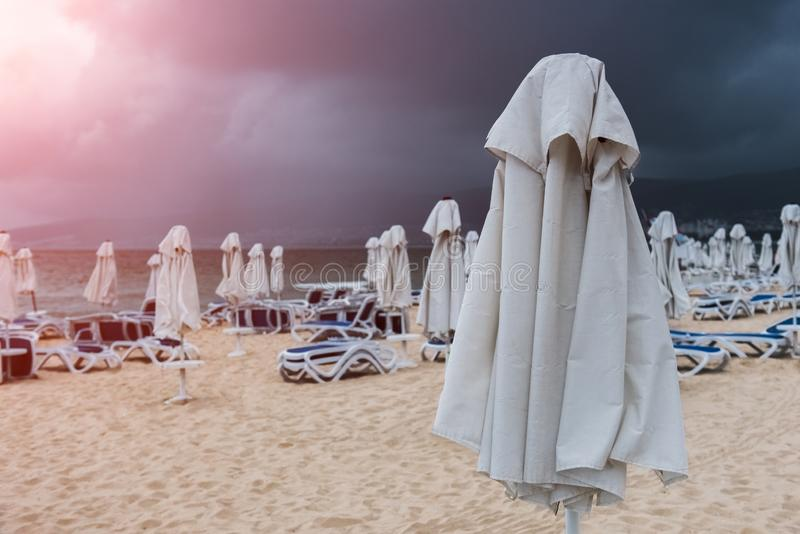 Lounge chairs and umbrellas on empty beach.  royalty free stock photography