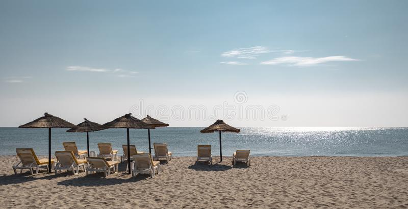 Lounge Chairs And Umbrellas On Tropical Island royalty free stock images