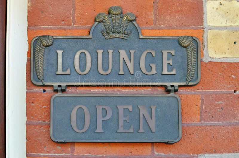 Lounge Open Sign. On a red brick wall stock photography