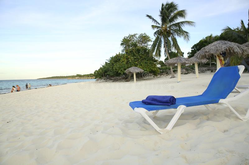 Lounger with towel on a tropical beach in the Caribbean stock photo