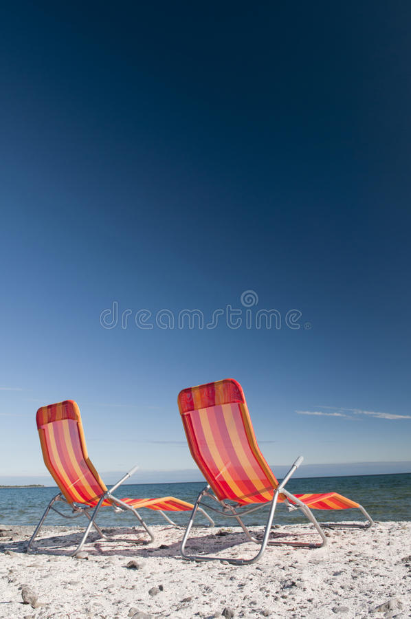 Download Beach Chairs On Lake Shoreline Stock Photo - Image: 29945102